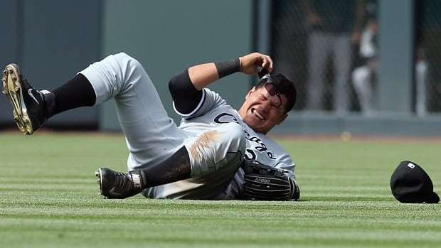 Avisail Garcia of the White Sox winces in pain after injuring his left shoulder in a 10-4 loss to the Rockies in Denver on April 9.