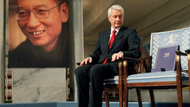 Chairman of the Norwegian Nobel Committee Thorbjoern Jagland looks down at the Nobel certificate and medal on the empty chair where Nobel Peace Prize winner jailed Chinese dissident Liu Xiaobo would have sat in December 2010. Relations between the two countries have chilled since then.