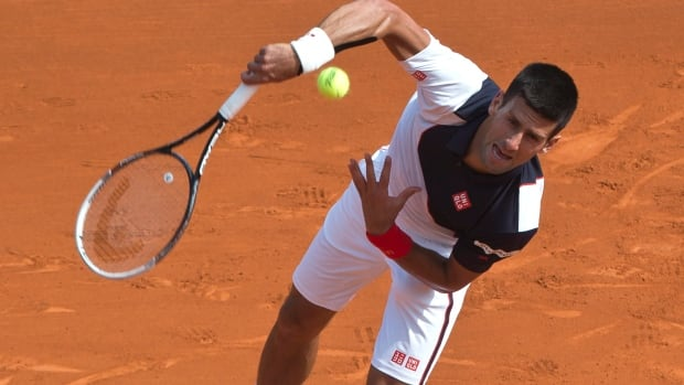 Novak Djokovic serves the ball to Albert Montanes of Spain during their match of the Monte Carlo Tennis Masters on Tuesday.