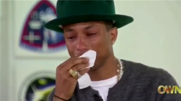 The pop star's hit song Happy has become a global phenomenon, and when Oprah showed Pharell fan-made videos from around the globe, he was reduced to tears.
