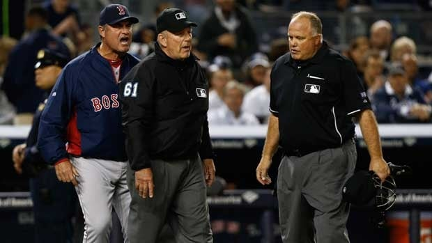 Boston Red Sox manager John Farrell, left, yells at the umpires after a disputed play this weekend against the New York Yankees.