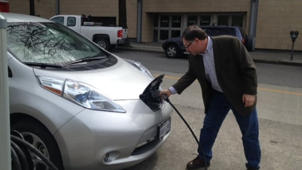 John Stonier says using an electric car saves him $250 each month