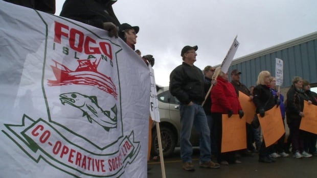 Protesters took to chanting outside the DFO offices in Grand Falls-Windsor on Tuesday to show their anger over the latest federal cuts to inshore northern shrimp quotas.