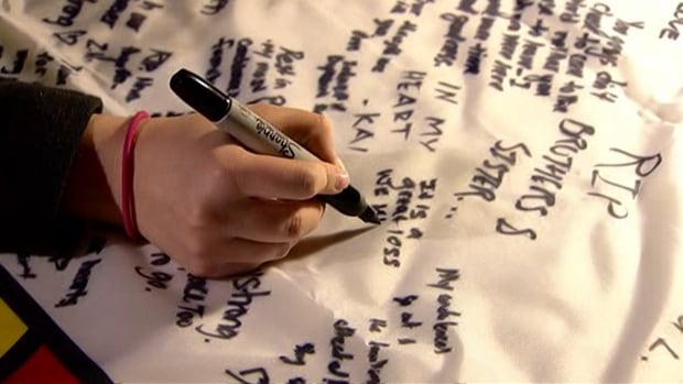 Students signed a flag of condolences at a University of Calgary vigil Tuesday afternoon.