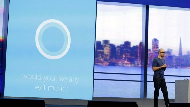 Microsoft CEO Satya Nadella carries on a conversation with the new personal assistant Cortana at the end of his keynote address to the recent Build Conference. Cortana is built into the soon-to-be-released Windows Phone 8.1.