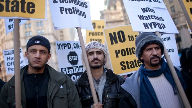 Men protest against the reportedly heavy-handedness of New York Police Department and Central Intelligence Agency on Muslim communities and neighbourhoods in New York in 2011. The NYPD confirmed Tuesday that detectives assigned to a unit that catalogues Muslims had been transferred to other duties.