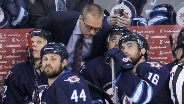 Winnipeg Jets head coach Paul Maurice talks to his players during a March 16 game at MTS Centre.