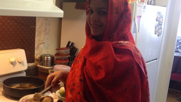 Shazia Iqbal cooks for friends and neighbours, and hopes to one day cook for many more, in her apartment's small kitchen.