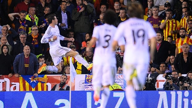 Real's Gareth Bale, left, celebrates after scoring his side's second goal during the final of the Copa del Rey between FC Barcelona and Real Madrid at the Mestalla stadium in Valencia, Spain, on Wednesday.