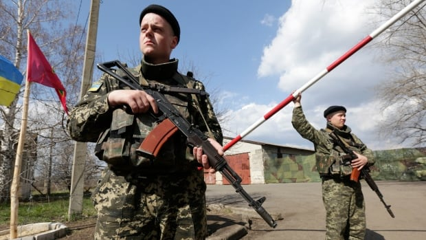 Ukrainian border guards stand on guard at a base close to the Russian border near Donetsk earlier this week. The Ukrainian Border Guard Service said Thursday it was introducing more stringent conditions on Russians.