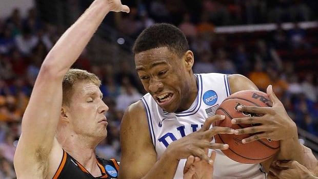 Duke forward Jabari Parker, right, is the highest-scoring freshman in Duke history, led the Blue Devils in scoring and rebounding and is the first freshman in three decades to be selected team MVP. He has decided to enter the NBA draft.