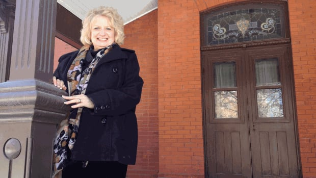 Wilma Derksen poses on the porch of the former Dalnavert Museum last month, when she announced plans to turn it into Candace House.