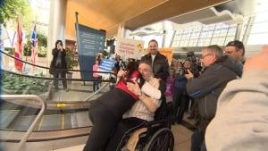 Kaetlyn Osmond hugging her grandfather, Moses Power