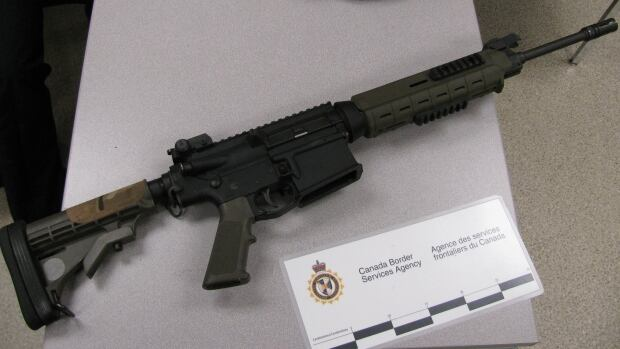 One of the rifles seized at the Beaver Creek, Yukon, border crossing in February.  Two U.S. residents are facing firearms smuggling charges after border services officers seized handguns and assault rifles in separate incidents.