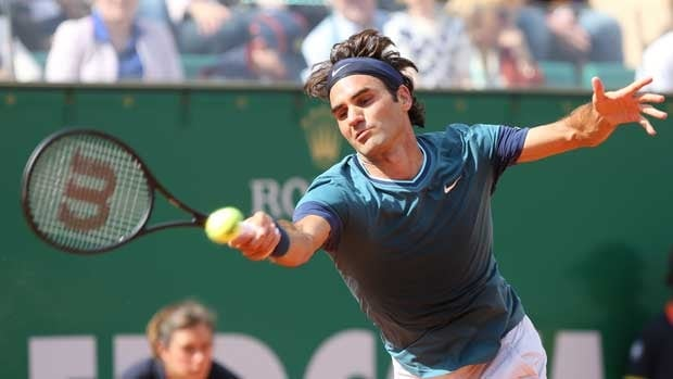 Roger Federer returns against Novak Djokovic in semifinal action on Saturday.