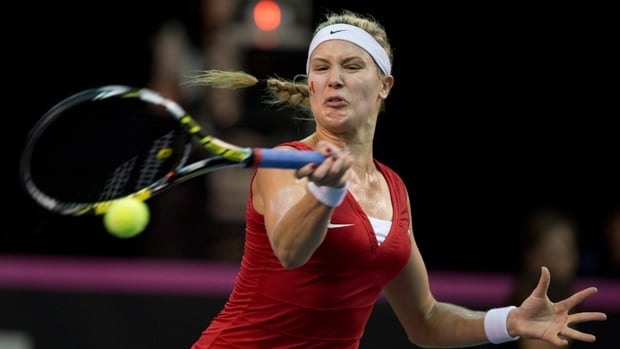 Eugenie Bouchard hits a forehand return in a 7-6, 2-6, 6-1 Fed Cup victory over Kristina Kucova at Laval University on Saturday.