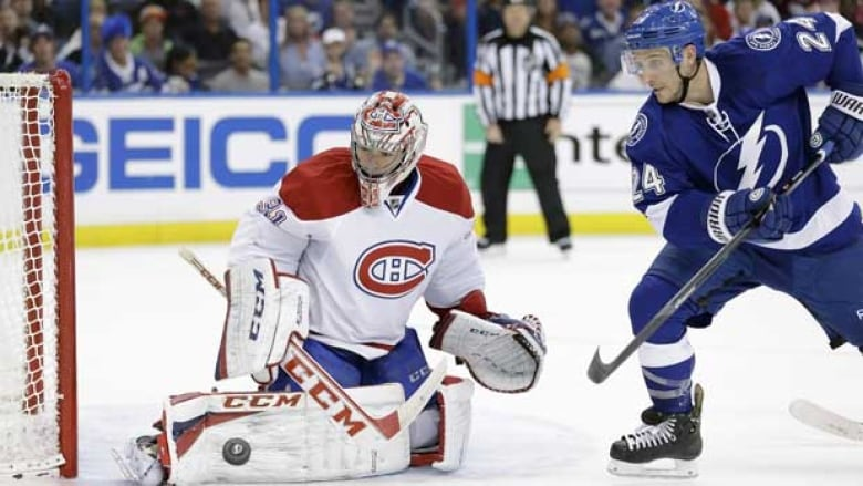 Montreal goaltender Carey Price makes the stop in front of Tampa Bay forward Ryan Callahan during action in the first game of the series.
