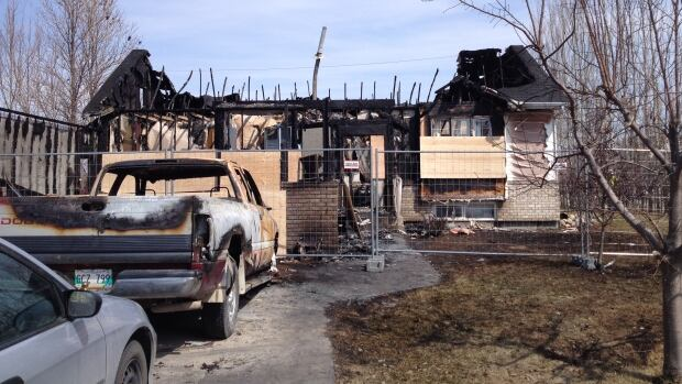The charred remains of a house in Lorette, Man., that was badly damaged by fire on Saturday evening. Fire officials say the house is a complete loss.