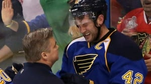 St. Louis Blues centre David Backes (42) is tended to by trainer Ray Barile after taking a hit from Chicago Blackhawks defenceman Brent Seabrook in the third period during Game 2 on Saturday.
