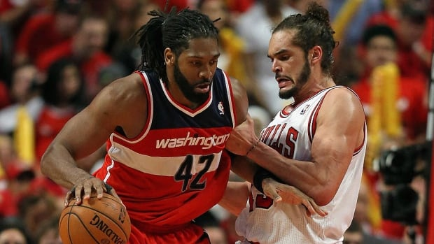 Bulls centre Joakim Noah, right, reportedly is the NBA's defensive player of the year after averaging career highs of 12.6 points, 11.3 rebounds and 5.4 assists.
