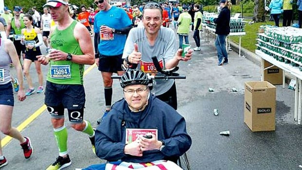 Boston Marathon racers Keith Butler and John Grant, shown here at a previous race, travelled from St. John's to compete in the 42-kilometre-long event in Boston. Grant, seated, has multiple sclerosis and was pushed during the race by his friend Butler on Monday.