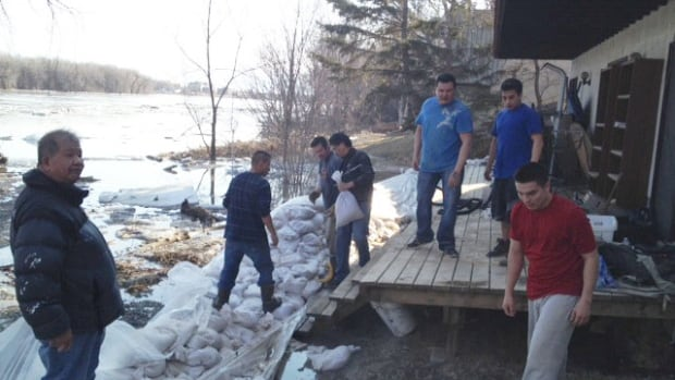 A dozen volunteers sandbagged a property on Cloutier Drive Monday afternoon