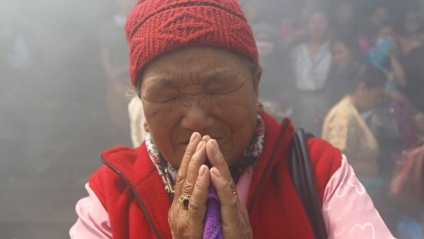 Mother of Ankaji Sherpa, who lost his life in an avalanche at Mount Everest last Friday, pays final tribute to her son during the cremation ceremony of Nepali Sherpa climbers in Kathmandu on Monday.