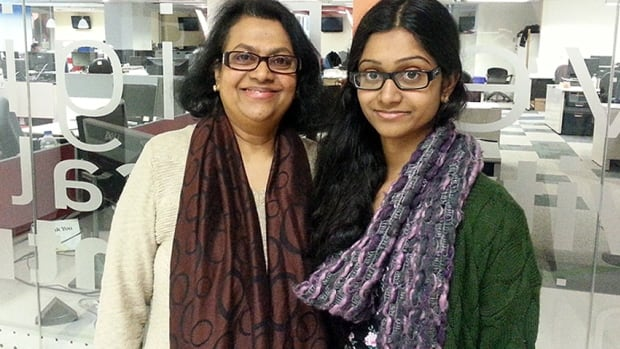 Nivatha Balendra (right) pictured with her mother Ramani. The 18-year-old scientist discovered oil-eating bacteria in her backyard and hopes that in the future it can be used to clean up oil spills.