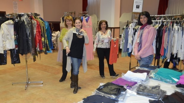 Volunteers gather for a group shot at an ActionS enfance charity sale in Outremont, April 2012.