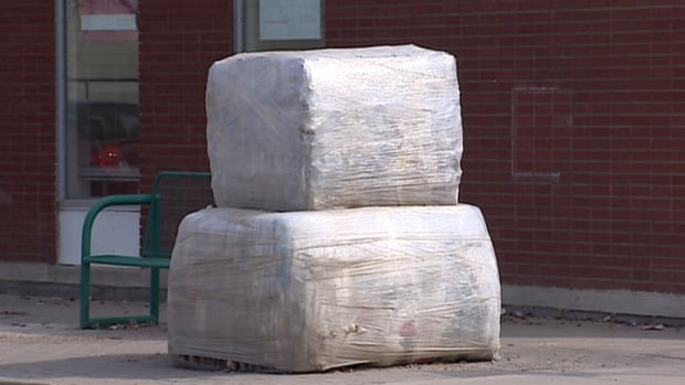 "'Found Compressions One and Two"" sits at the corner of 33rd Street West and Avenue C North. Together, the bales weigh 875 kg, and contain plastic bags and containers compressed by Loraas Recycling."