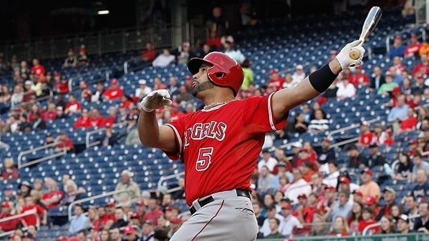Los Angeles Angels slugger Albert Pujols watches his three-run homer, against Washington Nationals starting pitcher Taylor Jordan, clear the fence during the first inning on Tuesday. That was Pujols 499th home run of his career.