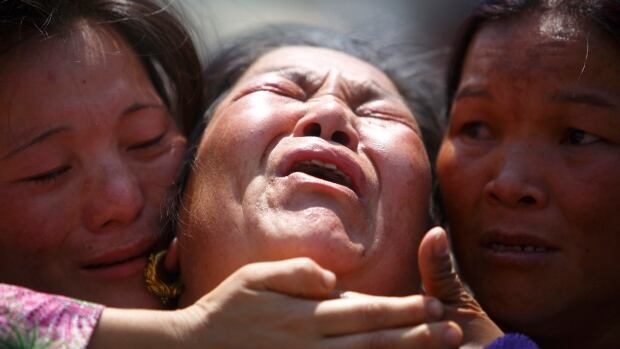 A family member a Sherpa climber is comforted by her relatives during a funeral rally of Nepali Sherpa climbers in Kathmandu on Monday.