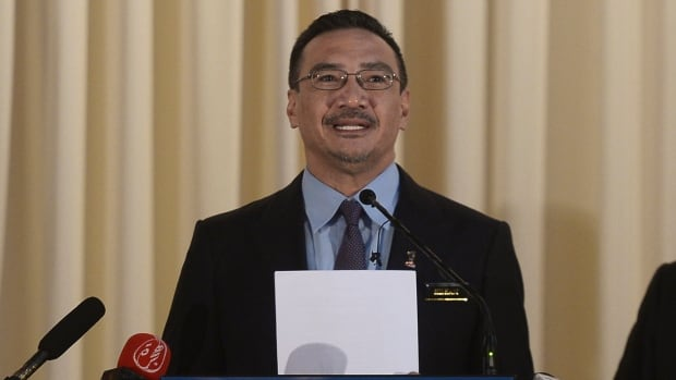 Malaysia's Defence Minister and acting Transport Minister Hishammuddin Hussein announced the cabinet approval of an international team to investigate the disappearance of missing Malaysia Airlines Flight MH370 at a news conference in Kuala Lampur on Wednesday.