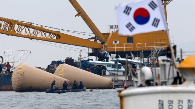 South Korean rescue workers operate near floats where capsized passenger ship Sewol sank on Wednesday, in the sea off Jindo April 22, 2014. The third mate's former professor says she told him she ordered a five-degree turn that went much further.
