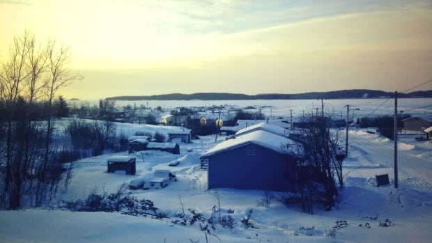 The sun rises over Fort Chipewyan, Alberta. Community members there say it's been an uphill battle to get funding to solar power in the community downstream from the oilsands. They're hoping a visit from California billionaire Tom Steyer will turn things around.