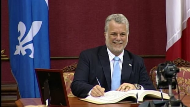 Liberal leader Philippe Couillard is sworn in as Quebec's 31st premier Wednesday afternoon in the National Assembly.