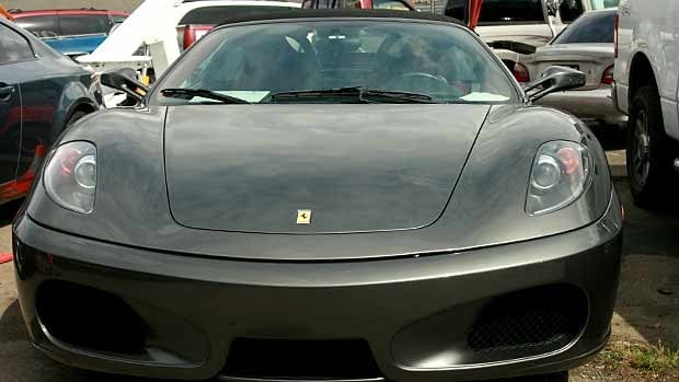 A Ferrari F430 is one of the cars G1Tour customers can take for a spin around the Blainville track at a cost of almost $1,000.00