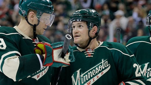 Wild forward Matt Cooke, right, drew a seven-game suspension from the NHL for the hit that knocked Colorado's Tyson Barrie out of action for 4-6 weeks.