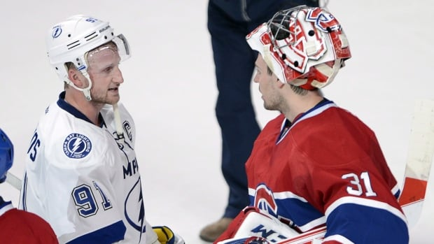 Lightning centre Steven Stamkos (91) shakes hands with Canadiens goalie Carey Price after Montreal swept Tampa Bay Tuesday night.