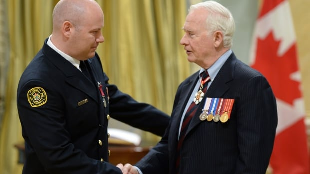 Gov. Gen. David Johnston presents the decoration of Bravery to Brian Darrell McRae of Calgary during a ceremony at Rideau Hall in Ottawa on Thursday.