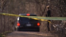 Coroner examines body found at Hog's Back Falls