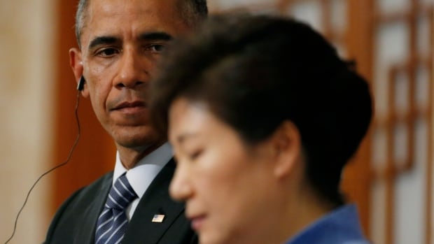 U.S. President Barack Obama looks toward South Korean President Park Geun-hye as she answers a question during a joint news conference at the Blue House in Seoul, South Korea, on Friday.