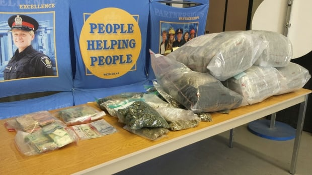 Police display about 40 pounds of pot and $40,000 seized from an apartment building in Cambridge on Eagle Street on Wednesday, April 23.