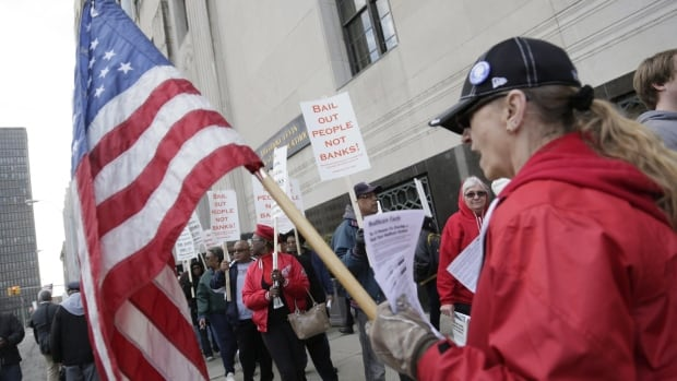 Protestors rally against deeper cuts in pensions in front of the Theodore Levin Federal Courthouse in Detroit on Apr. 1, 2014. A committee representing Detroit's retired workers reached an agreement with the city over pensions and healthcare on Friday.