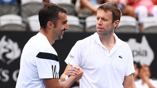 Nenad Zimonjic, left, and Canada's Daniel Nestor, right, defeated Croatian Ivan Dodig and Marcelo Melo of Brazil 6-4, 6-4 on Saturday to reach the doubles final at the Barcelona Open.