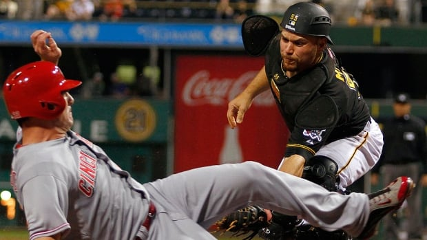 Pirates catcher Russell Martin, right, strained his left hamstring in the sixth inning of Friday's 1-0 loss to St. Louis. The Montreal native is hitting .242 in 16 games this season.