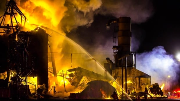 A fire tore through the Gibbons, Alta. grain elevator Friday night.