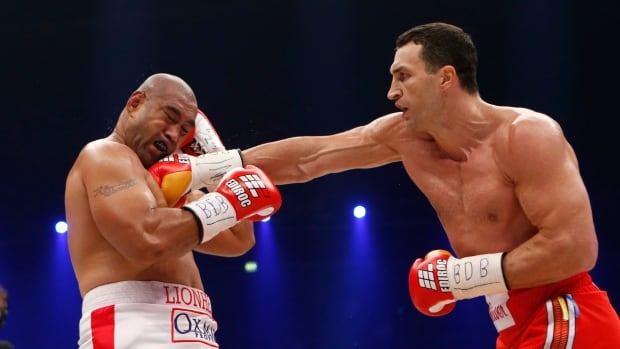 IBF, WBA, WBO and IBO champion Wladimir Klitschko from Ukraine, right, punches his Australian challenger Alex Leapai during their heavyweight world title bout in Oberhausen, western Germany on Saturday.
