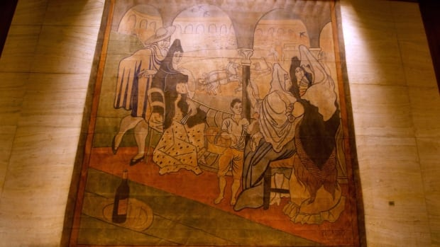 A stage curtain painted by Pablo Picasso hangs on a wall at the Four Seasons restaurant in New York. Plans to move the 1919 canvas from the eatery has touched off a dispute between a prominent preservation group against an art-loving real estate magnate.