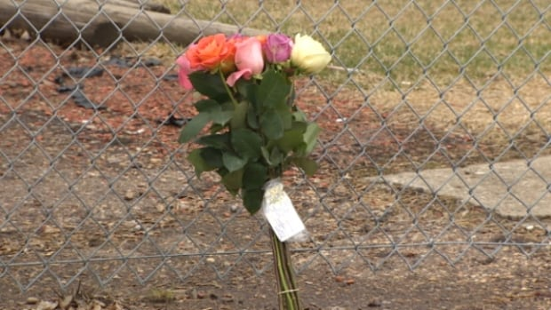 On Sunday, someone left flowers and a note just outside the west Edmonton apartment. The note is signed from 'Mom.'